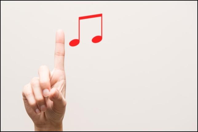 人差し指で16部音符を案内する画像